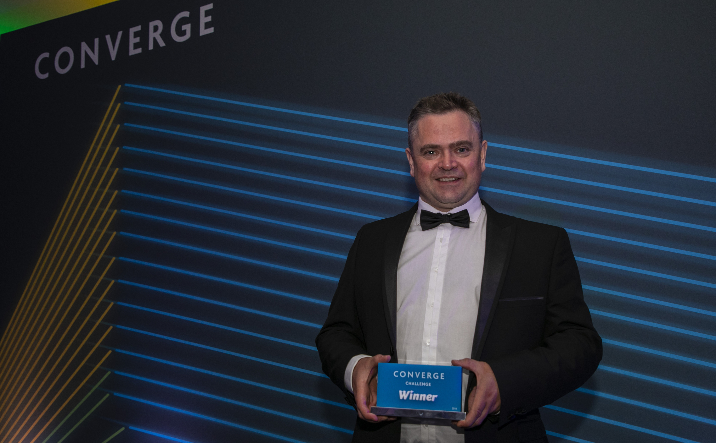 Andrew Woodland with his award
