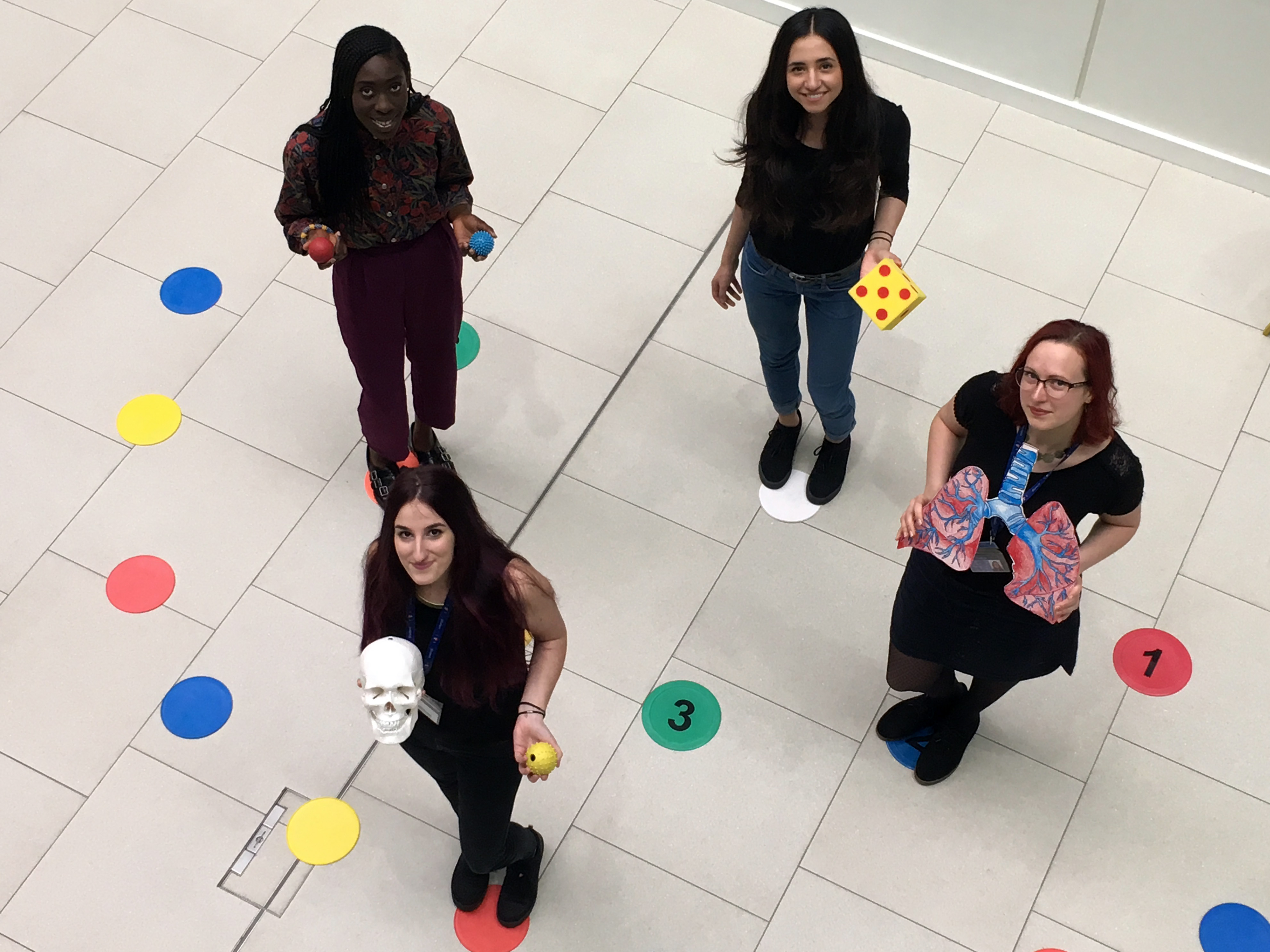 Playing a game about the workings of stem cells are (l-r) PhD students Theresa Tachie-Menson, Anna Seggara Fas, Alexia Kalogeropulou, and Elena Purlyte