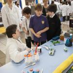 A group of boys learn about microbial biohydrogen production.